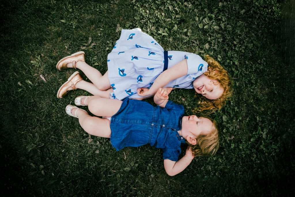 Little girls playing in the grass