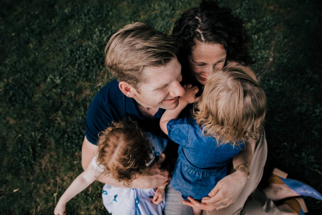 family hugging in the hudson valley